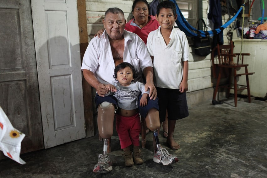 Doroteo Correa (left), poses with his wife Arsenia Petch and two of his grandchildren