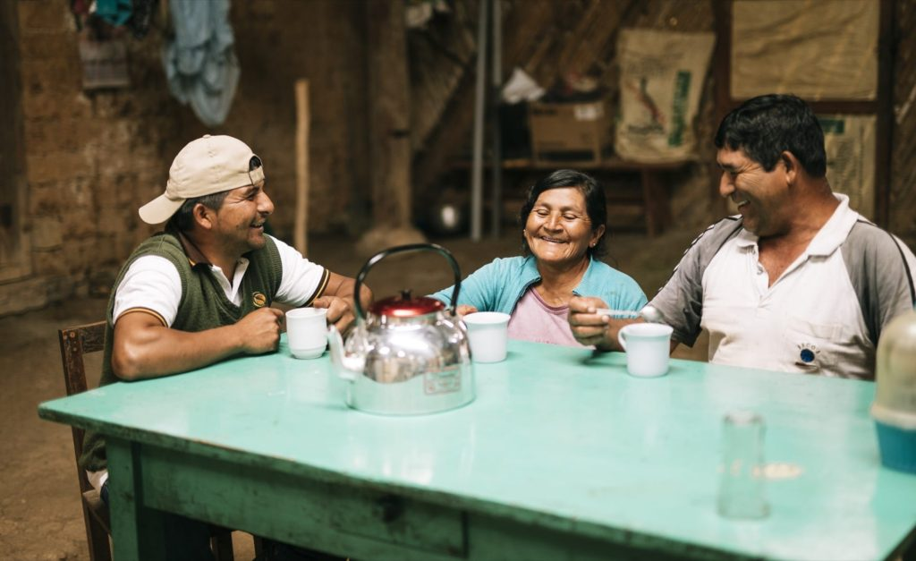 Image of Edgar Chasquero Ocaña (wearing the vest) enjoying a cup of coffee